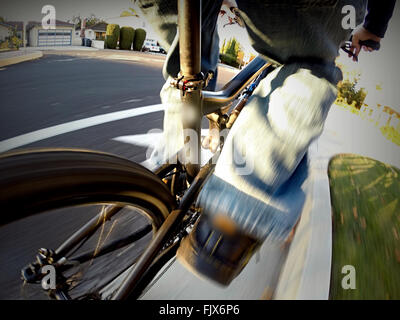 Low Section Of Man Cycling On City Street - Stock Photo