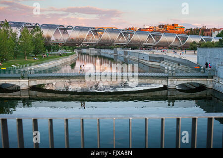 Manzanares river, in background Arganzuela Bridge by Dominique Perrault, Madrid Rio Park. Madrid, Spain - Stock Photo
