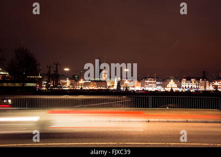 Light Trails Over Street In City Against Sky At Night - Stock Photo