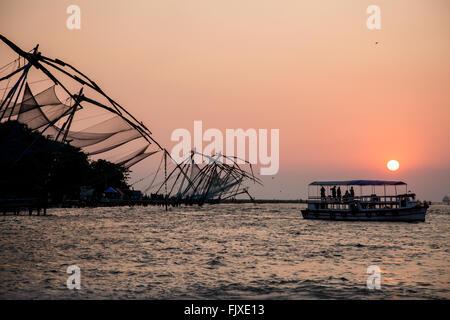 Sunset over the Chinese Fishing Nets Cochin Kerala India - Stock Photo