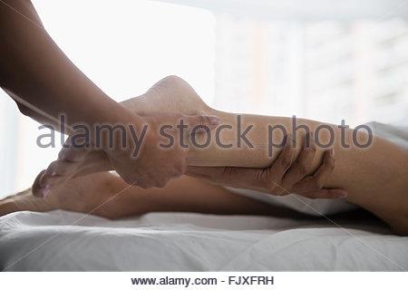 Woman receiving leg massage - Stock Photo