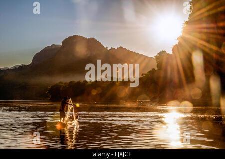 Asia. South-East Asia. Laos. Province of Luang Prabang. Fisherman on Mekong river at sunset. - Stock Photo