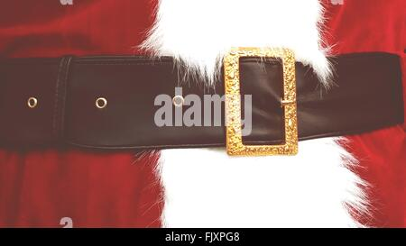 Midsection Of Person In Santa Claus Costume - Stock Photo