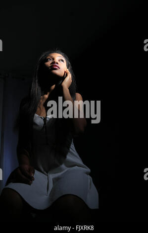 Front View Of Fashion Model Against Black Background - Stock Photo