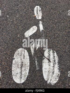 High Angle View Of Bicycle Lane Marking On Street - Stock Photo