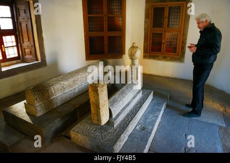 Mevlana Museum, city of Konya, Turkey. The 16C tomb mausoleum of Hurrem Pasha in the mosque courtyard - Stock Photo
