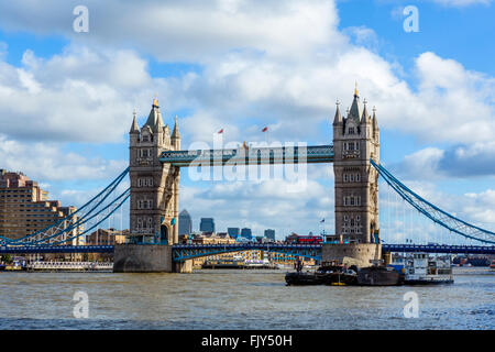 Tower Bridge from the South Bank with the skyscrapers of Canary Wharf in the distance, London, England, UK - Stock Photo