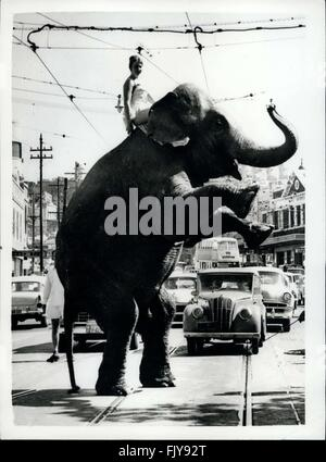 1952 - Some Pedestrian!: In this era of space travel, nothing seems impossible. Not even the extraordinary spectacles of an elephant on its hind legs crossing a busy road in Rushcutters Bay, Sydney, Australia. Tanya Natashia startled drivers when she piloted the elephant, from Ashton's Circus, through the traffic to find new grazing grounds. © Keystone Pictures USA/ZUMAPRESS.com/Alamy Live News