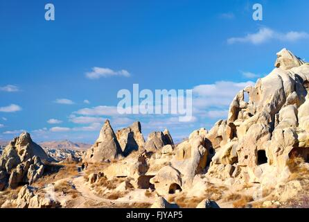Eroded volcanic tuff early Christian troglodyte cave dwelling rooms in Goreme Open Air Museum National Park, Cappadocia, - Stock Photo