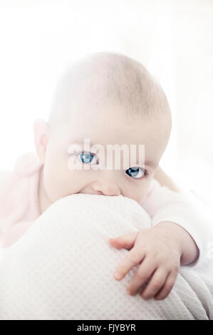 beautiful baby girl in her mother's arms - Stock Photo