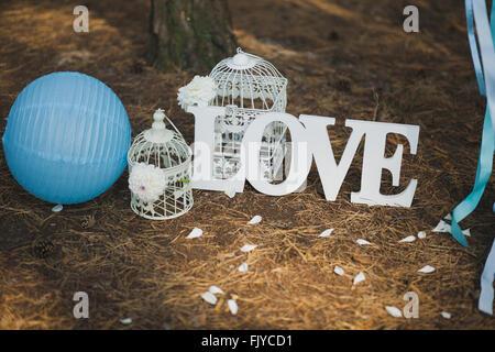 Love - wooden inscription. Wedding decor. - Stock Photo