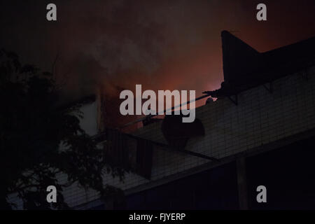 Low Angle View Smoke Emitting From Building Against Sky At Night - Stock Photo