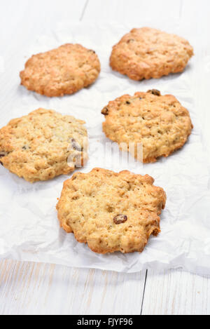 Healthy oats cookies on white baking paper - Stock Photo