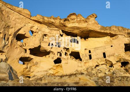 Part of cliff dwelling complex of ancient Christian churches and houses in village of Cavusin near Goreme, Cappadocia, - Stock Photo
