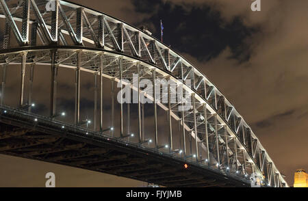 View taken at night from below Sydney Harbour Bridge looking toward the CBD and Circular Quay. - Stock Photo