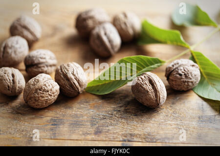 Walnuts on wooden table - Stock Photo