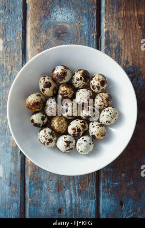 Quail eggs on wooden table - Stock Photo