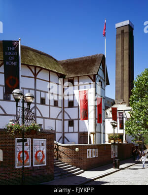SHAKESPEARE'S GLOBE THEATRE, Bankside, London. General view of the theatre with the chimney of Tate Modern beyond. - Stock Photo