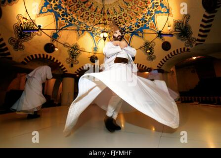 Traditional Turkish Sufi Whirling Dervish spiritual evening at Dervis Evi on in town of Ortahisar, Goreme, Cappadocia, - Stock Photo