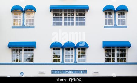 Front facade of art deco hotel Shore Park on Ocean Drive in South Beach district of Miami Beach, Florida, USA - Stock Photo