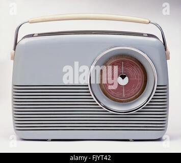 Old fashioned grey plastic and metal portable radio with handle - Stock Photo