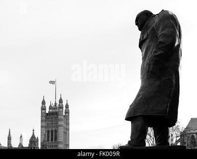 Statue of Sir Winston Churchill with the Palace of Westminster behind, Parliament Square, Westminster, London, England, - Stock Photo