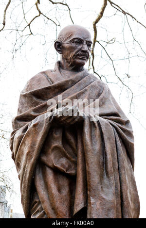 Statue of Mahatma Gandhi in Parliament Square, Westminster, London, England, UK - Stock Photo