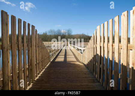 New wooden pedestrian access bridge over wetland nature reserve - Stock Photo