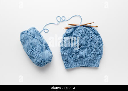 Hat knitted with four knitting needles - Stock Photo