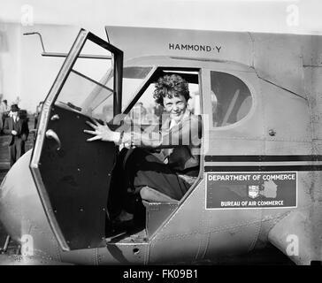 Amelia Earhart, Portrait Sitting in Airplane, USA, circa 1936.jpg - Stock Photo