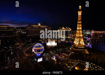 View of Paris Las Vegas and Bellagio Hotel & Casino at night - Stock Photo