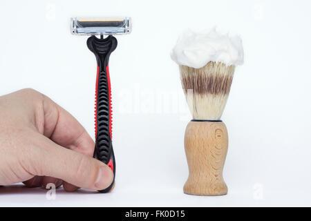Modern shaving razor and old shaving brush isolated on white background - Stock Photo