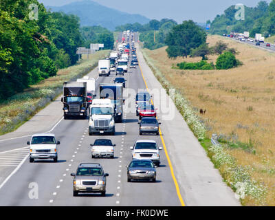 Heavy Highway Traffic On Hot Summer Day - Stock Photo