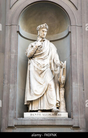 Statue of the poet and writer Dante Alighieri outside of the Uffizi Gallery in Florence, Italy. - Stock Photo