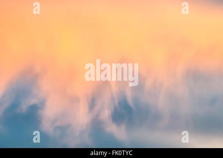 Stratus clouds illuminated by the setting sun. Othello, Washington, United States. - Stock Photo