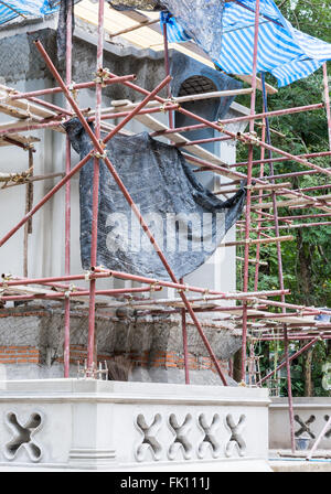 New Thai church in under construction with metal scaffold. - Stock Photo