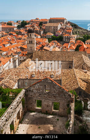 Dubrovnik, Croatia city view with red roofs overlooks the sea with island with ruined house in foreground - Stock Photo