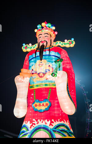 Singapore, 09 Feb 2016: Huge statue of God of Fortune for Chinese New Year decoration.The River Hongbao festivities - Stock Photo