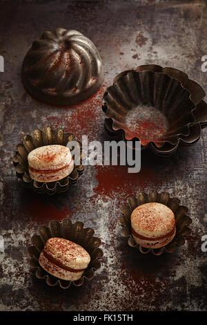Caramel and chocolate macarons - Stock Photo