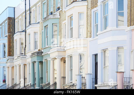Pastel color houses facades in London - Stock Photo
