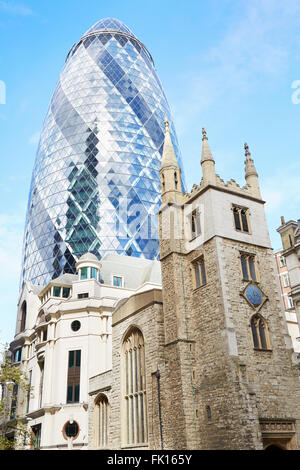 St. Andrew Undershaft Church with 30 St. Mary Axe above in a sunny day in London - Stock Photo