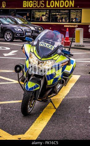 London, UK. Metropolitan Police Motorcycle parked on a junction - Stock Photo