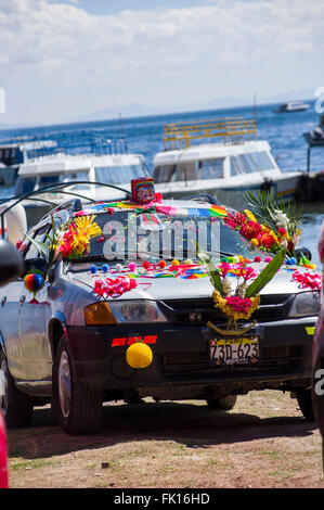 A car adorned with symbolic decorations after being blessed by a priest of the Church of the Virgin of Copacabana, - Stock Photo
