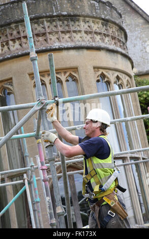 Close-up of a scaffolder working at Tyntesfield House, a National Trust owned stately home near Bristol - Stock Photo