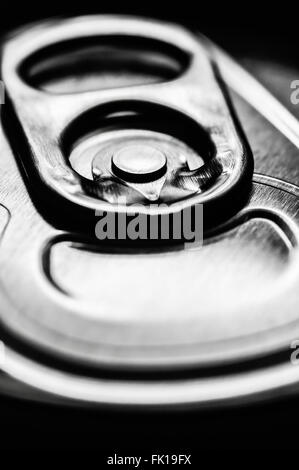 Silver aluminum soda pop can top ring pull tab - Stock Photo