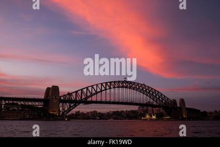 A colourful dusk over Sydney Harbour Bridge - Stock Photo