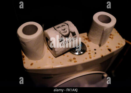 A figure of Russian President Vladimir Putin on a toilet paper in a shabby bar in Kiev Ukraine - Stock Photo