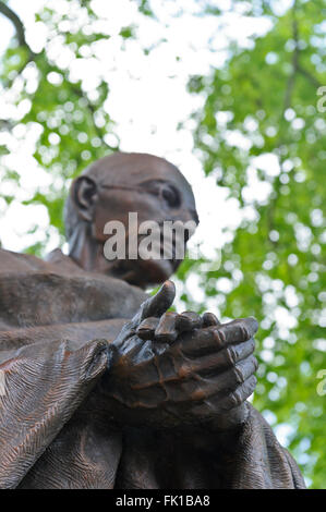 The statue of Mahatma Gandhi in Parliament Square, is a work by the sculptor Philip Jackson, London, United Kingdom. - Stock Photo