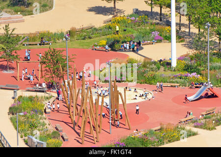 Kids playing outdoors in playground area Queen Elizabeth Olympic Park at Stratford Newham East London England UK - Stock Photo