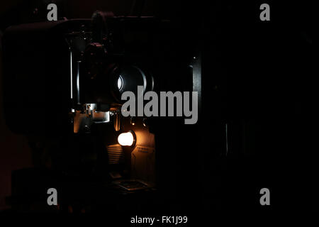 Film projector showing movie - Stock Photo